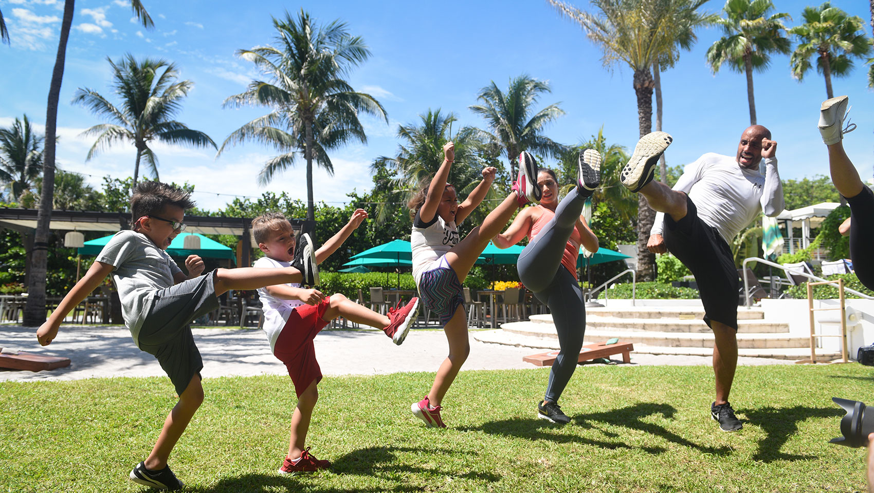 kids bootcamp class with instructor in our Surfcomber backyard